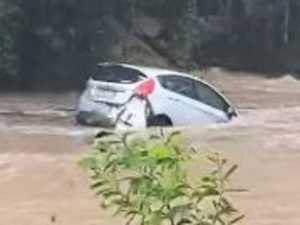 Dramatic moment car swept away in flood