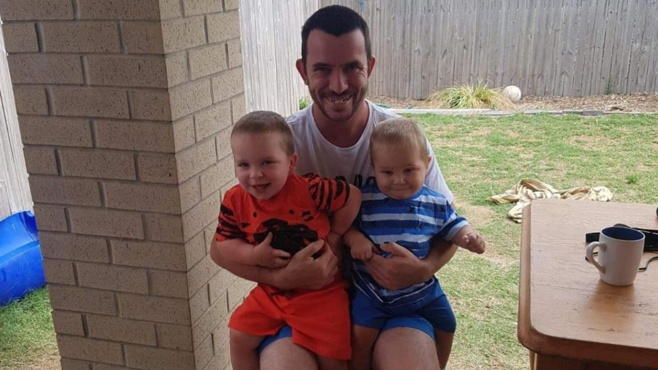 Darren Adcock, pictured with his two sons, has been in a coma since March 11. Picture: Supplied.