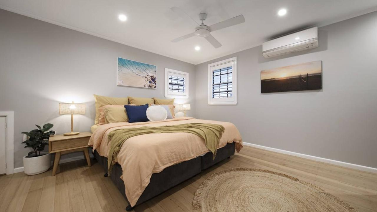 The spacious master bedroom post-renovation.