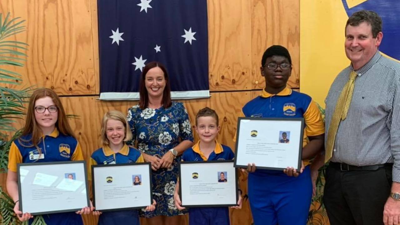 Brittany Lauga with Mount Archer State School principal Jeff Jepson and students Madeline, Madison, Zach and Daanish.