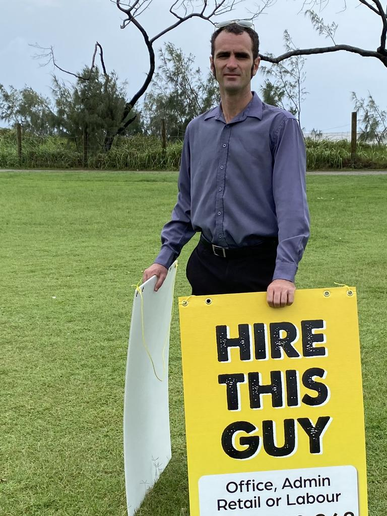 """Anthony Ilett has been searching for a job for weeks and has taken to walking up and down the Esplanade with sign saying """"hire this guy"""" hoping to draw attention."""