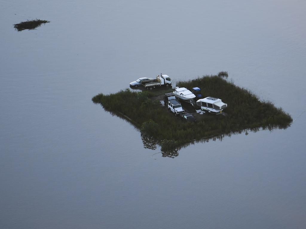 This patch of land with cars, a caravan and boat are seen from a helicopter in the Windsor area near Sydney, Wednesday, March 24, 2021. Picture: Lukas Coch/Pool/AAP