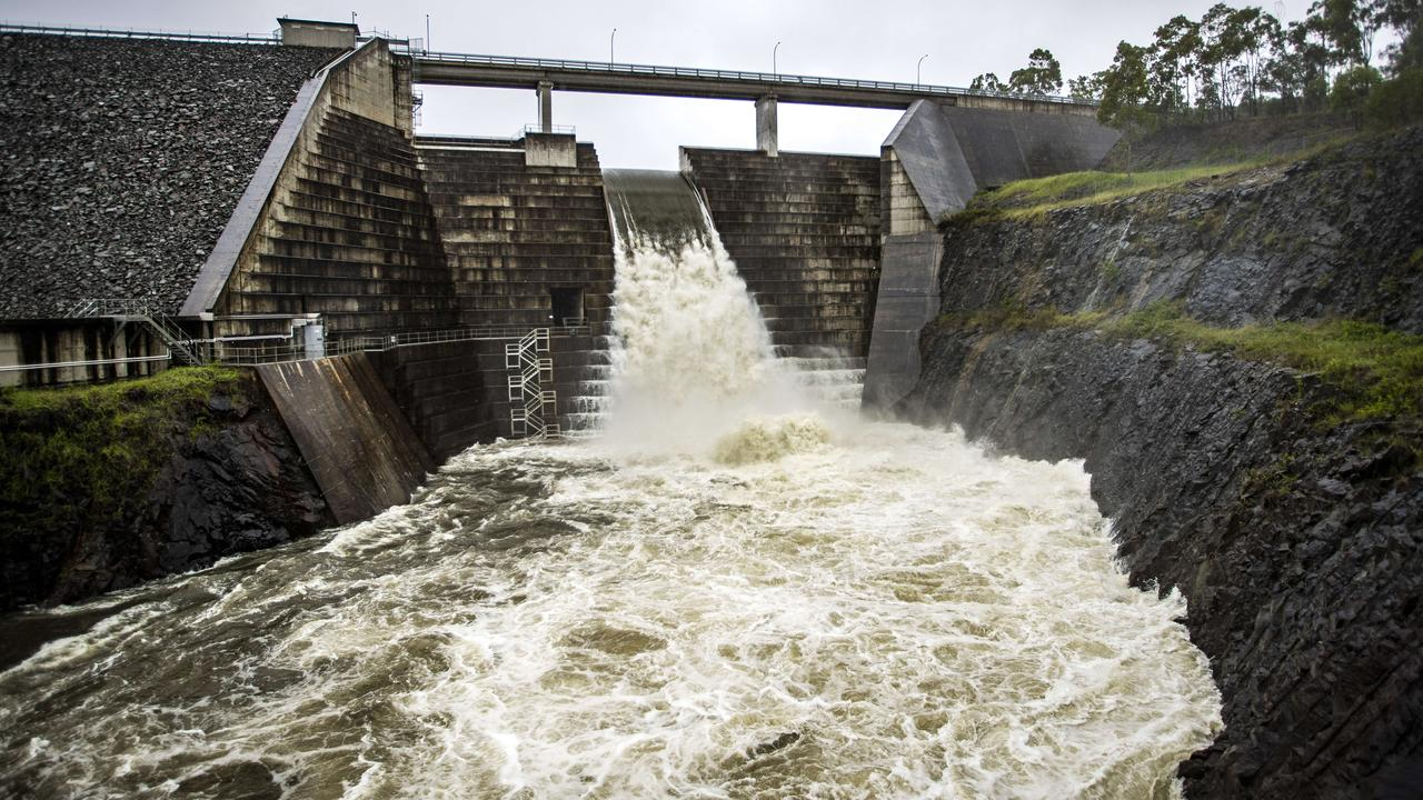 The Hinze Dam overflowing. Picture: NIGEL HALLETT