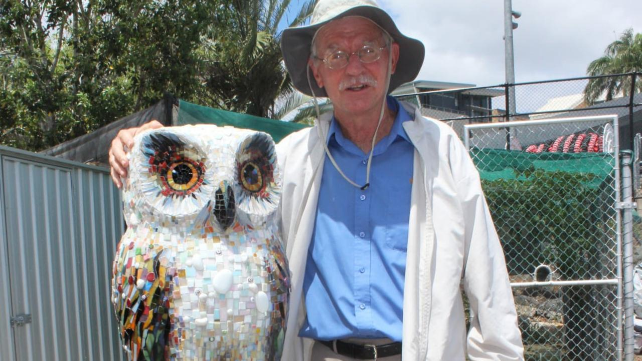 Now retired Rockhampton Grammar teacher Peter Moodie with Mr Owl, a mosaic statue made in his honour which disappeared from the school garden last month.