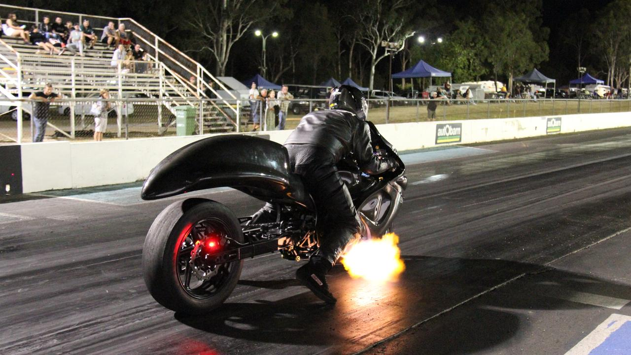 Flames spit from the exhaust of Matt Walker's turbocharged Suzuki Hayabusa as he prepares to launch at Benaraby dragway. Picture: Rodney Stevens
