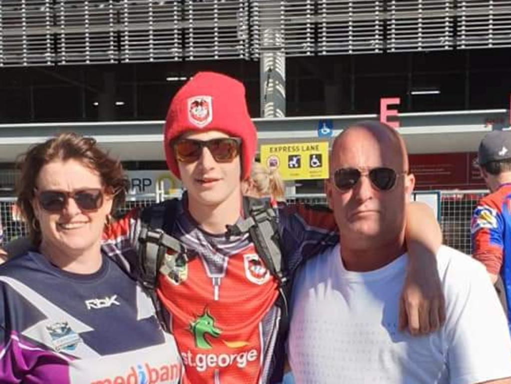 Mitch with his parents Clint and Deb. Picture: Supplied