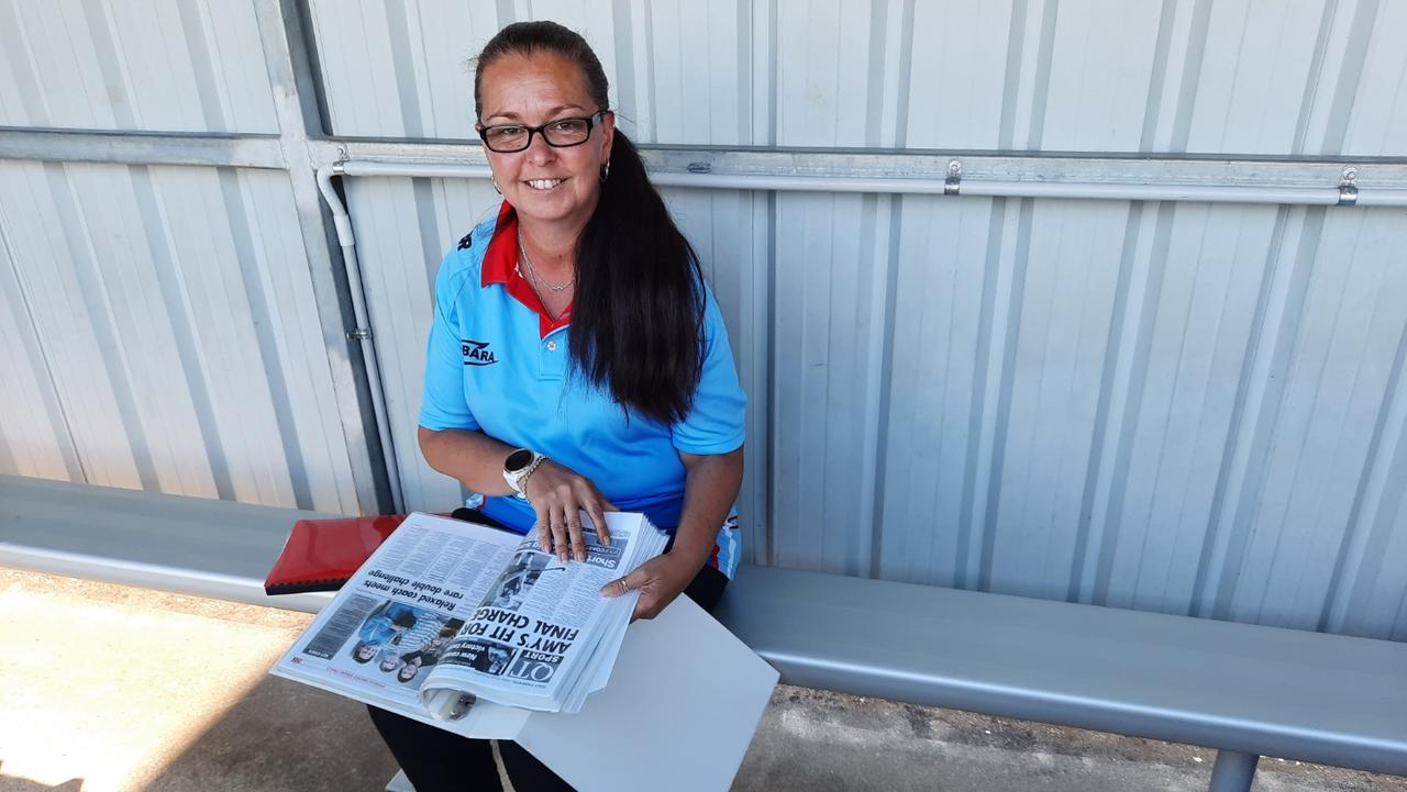 Swifts Hockey Club secretary Terresa Peterson browses through 15 years of club history captured through many Queensland Times articles and photos. Picture: David Lems
