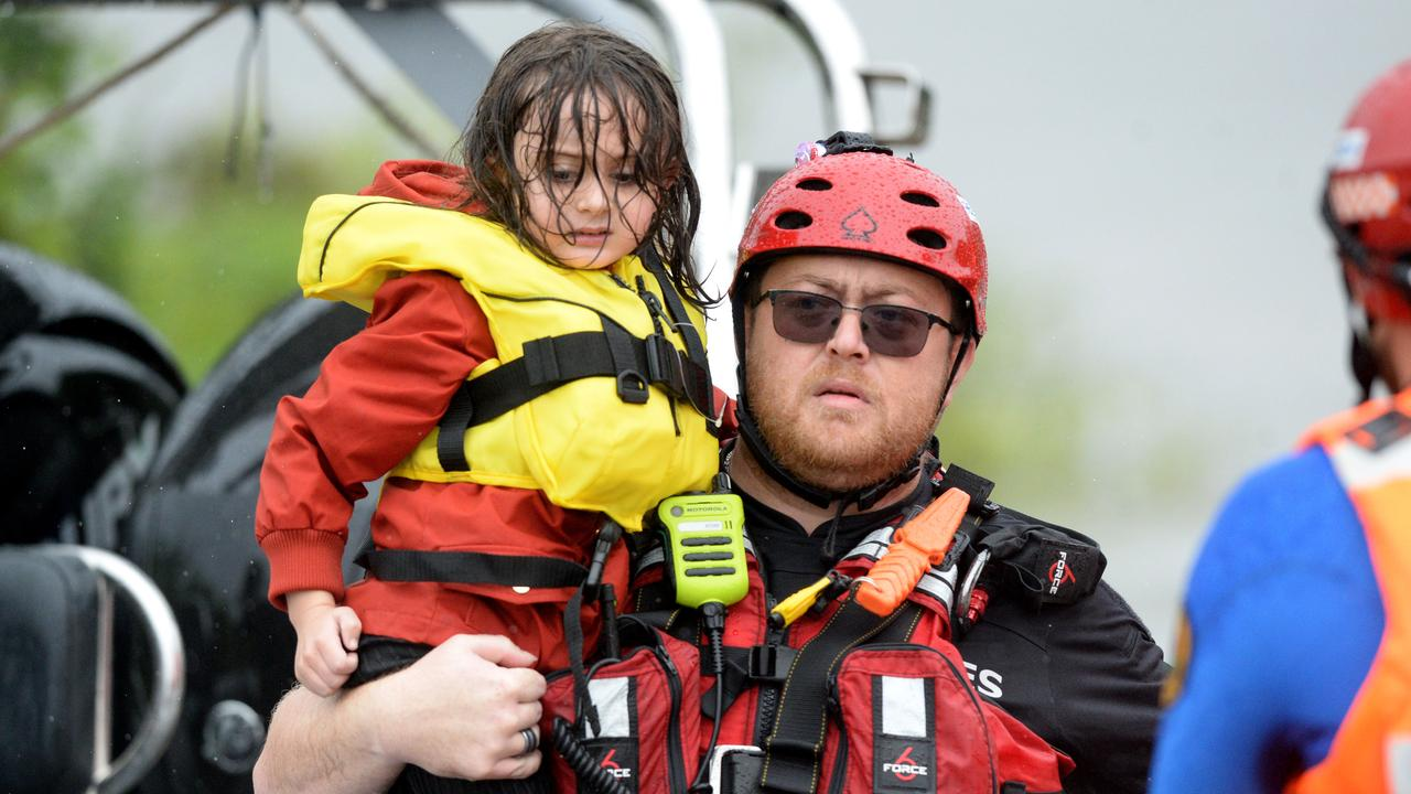 Families rescued from their Upper Colo home. Picture: NCA NewsWire / Jeremy Piper