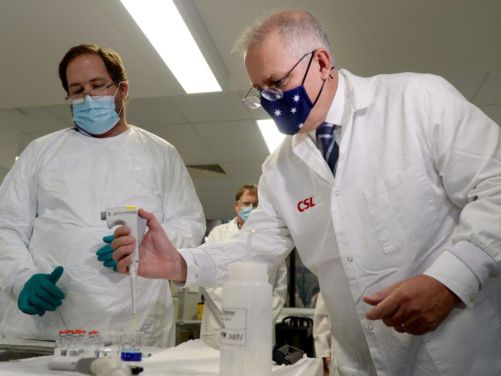 Prime Minister Scott Morrison meets CSL staff working on the COVID vaccine while he tours the company's facility in Melbourne. Picture: NCA NewsWire / Andrew Henshaw