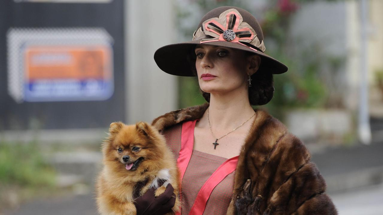 Actor Danielle Cormack, as underworld boss Kate Leigh, holds the pomeranian that starred in Underbelly: Razor before it died and was whisked to Markus Michalowitz's workshop.