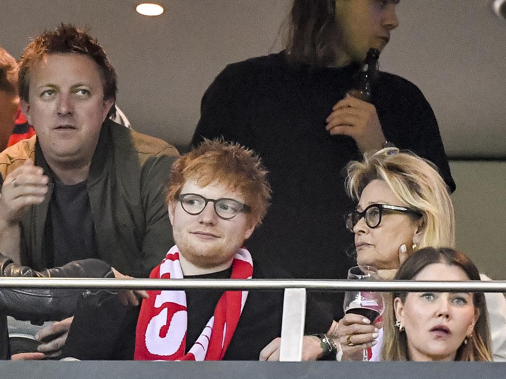 Ed Sheeran joins the Gudinski family in a corporate box at the game. Picture: Jake Nowakowski