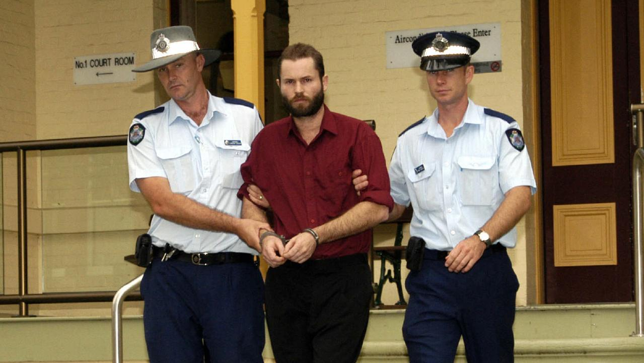 Hit man Michael John Kinsella is escorted by police from Maryborough Court after pleading guilty to the murder of Ingrid Lester in 2002. Picture: John Wilson
