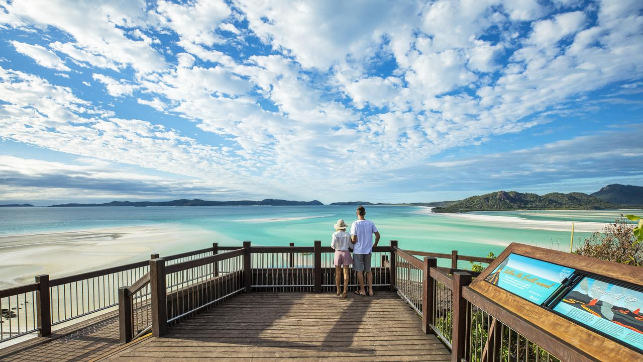 Couple looking out to the view, Whitsunday Island. Picture: Brooke Miles for Riptide Creative