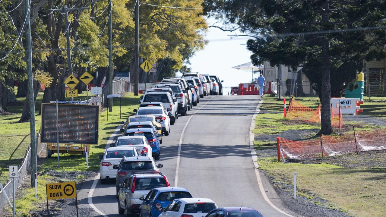 Cars line up while drivers wait for testing at Baillie Henderson COVID-19 fever clinic. Thursday, 30th Jul, 2020.