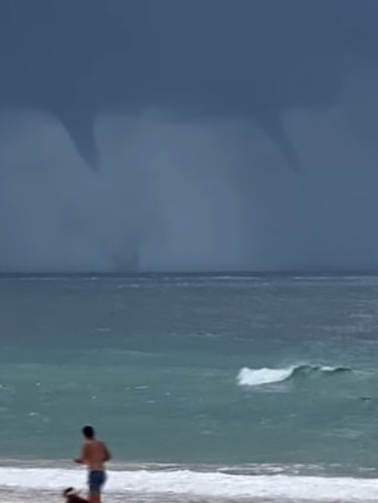 Twin Water spouts captured on film off Rainbow Beach on March 30, 2021. Photo courtesy of Higgins Storm Chasers video screenshot.