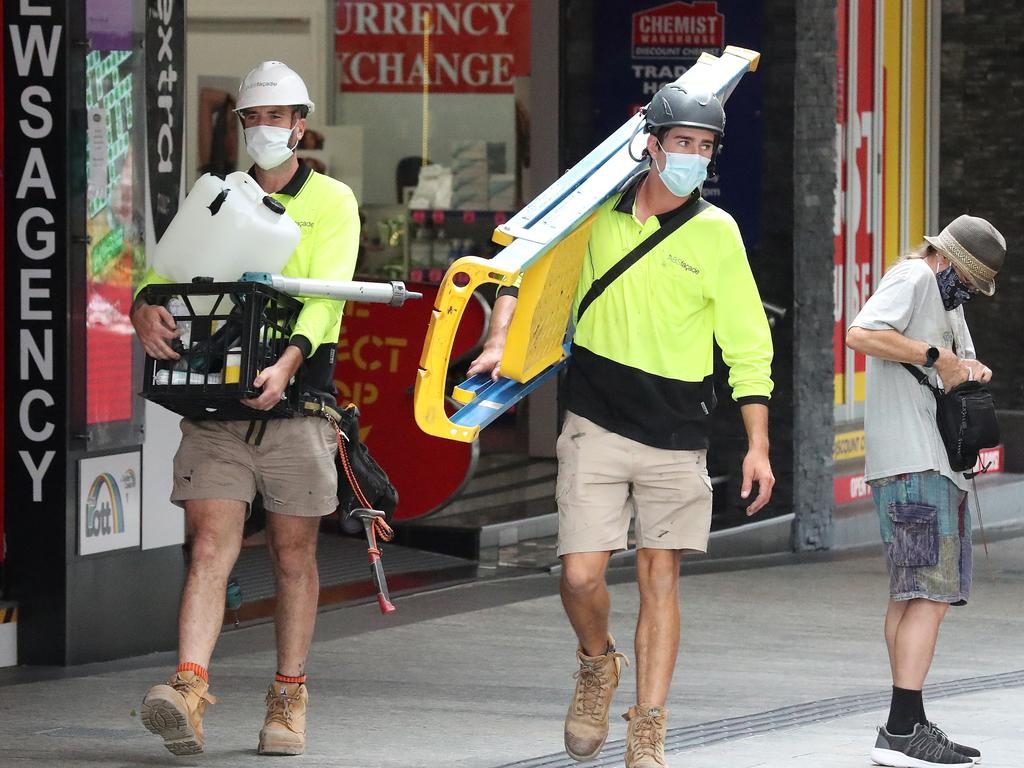 Tradesmen wearing their masks in Queens Street Mall. Picture: Liam Kidston.