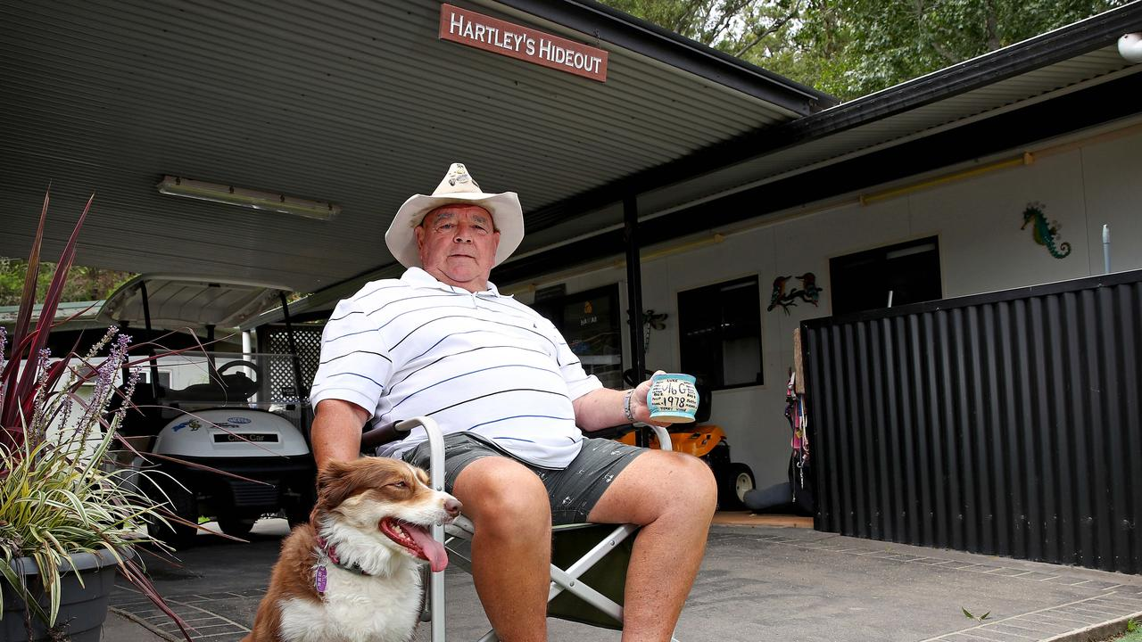 Before: Former NRL referee Greg 'Hollywood' Hartley and his dog, Elly, at his home on the banks of the Hawkesbury River at Leetsvale. Picture: Toby Zerna