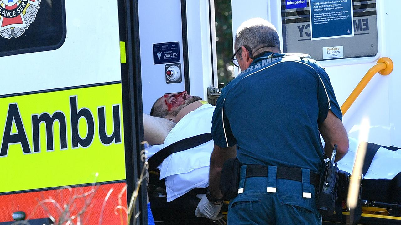 Dylan Matthew Hammond is loaded into an ambulance in 2019 after being shot and run over in a dramatic end to a massive Bruce Highway police chase. Picture: John McCutcheon