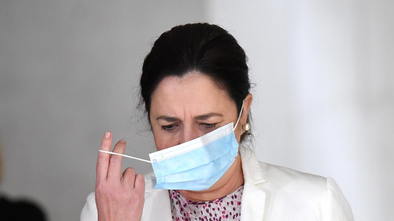Queensland Premier Annastacia Palaszczuk arrives at Tuesday's press conference with a mask. Picture: NCA NewsWire / Dan Peled