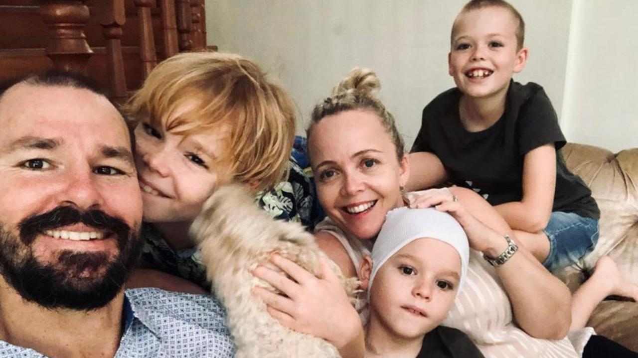 Hayden Price, 8, pictured with his family, has undergone surgery to have a rare melanoma not sun related removed from his head.