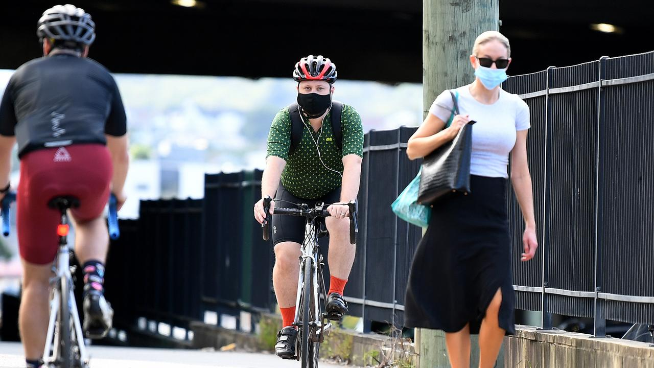 Morning commuters wear face masks in Brisbane after a three-day lockdown was imposed. Picture: NCA NewsWire / Dan Peled