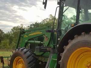 Tractor crashes into power lines on property near Dalby