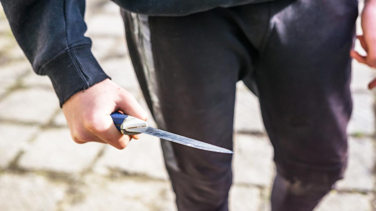 A man has been seriously injured after he deliberately stabbed himself in the chest to settle a drug debt.