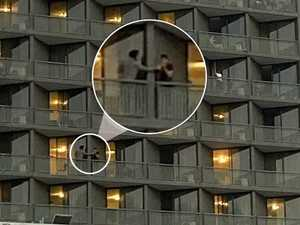 Shock as quarantined travellers share items over balcony