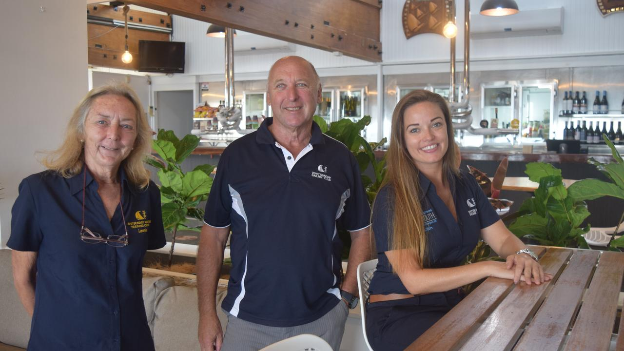 Whitsunday Sailing Club is gearing up to celebrate its 50th birthday. Pictured are club secretary Leonie Matthews, sailing manager Ross Chisholm and event manager Caitlin McLuskey. Photo: Elyse Wurm