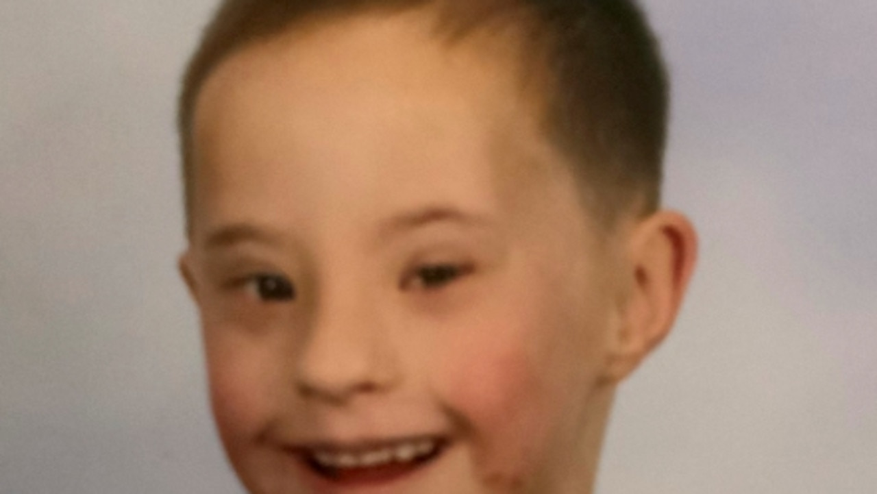 The body of a young boy with Down syndrome has been discovered in a dam 24 hours after he disappeared.