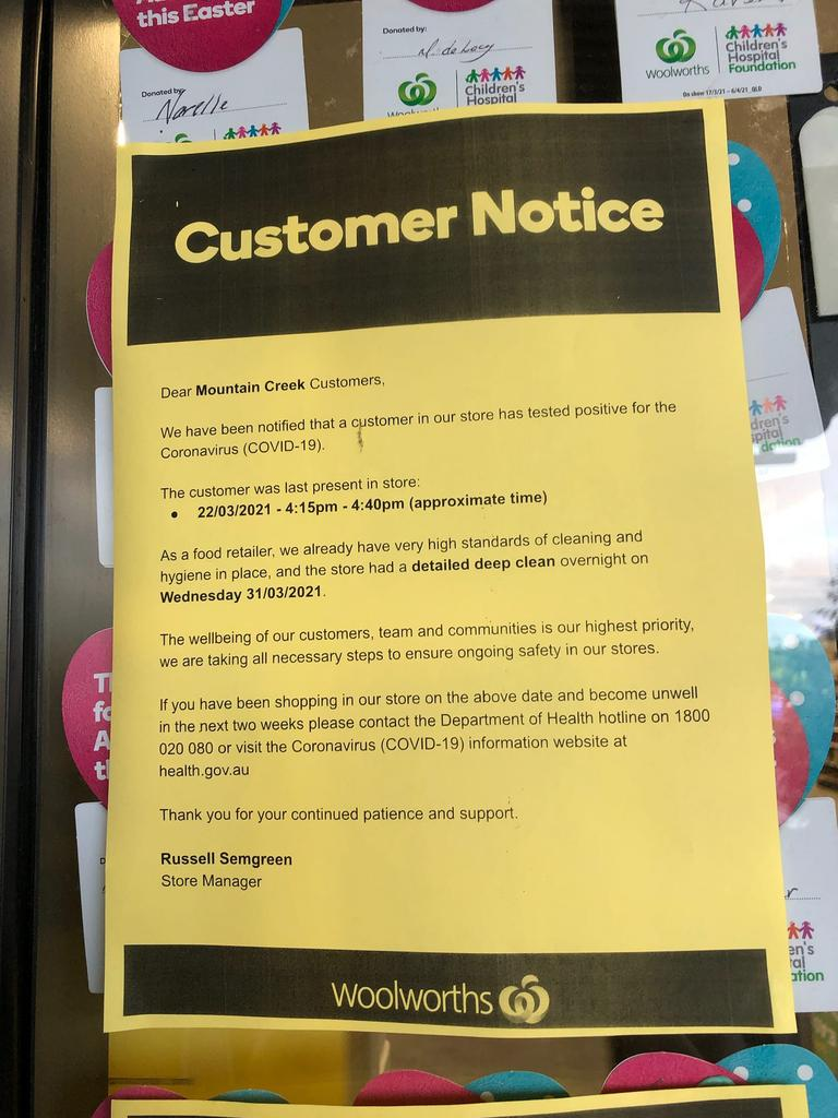 A sign at Mountain Creek Woolworths saying a customer who tested positive to COVID-19 visited the store. Queensland Health says the information is incorrect.