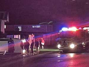 Car crashes through fence, flips on Coast road