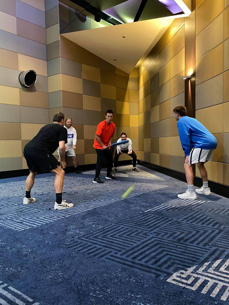 Brisbane players work on their indoor cricket skills in the team hotel.