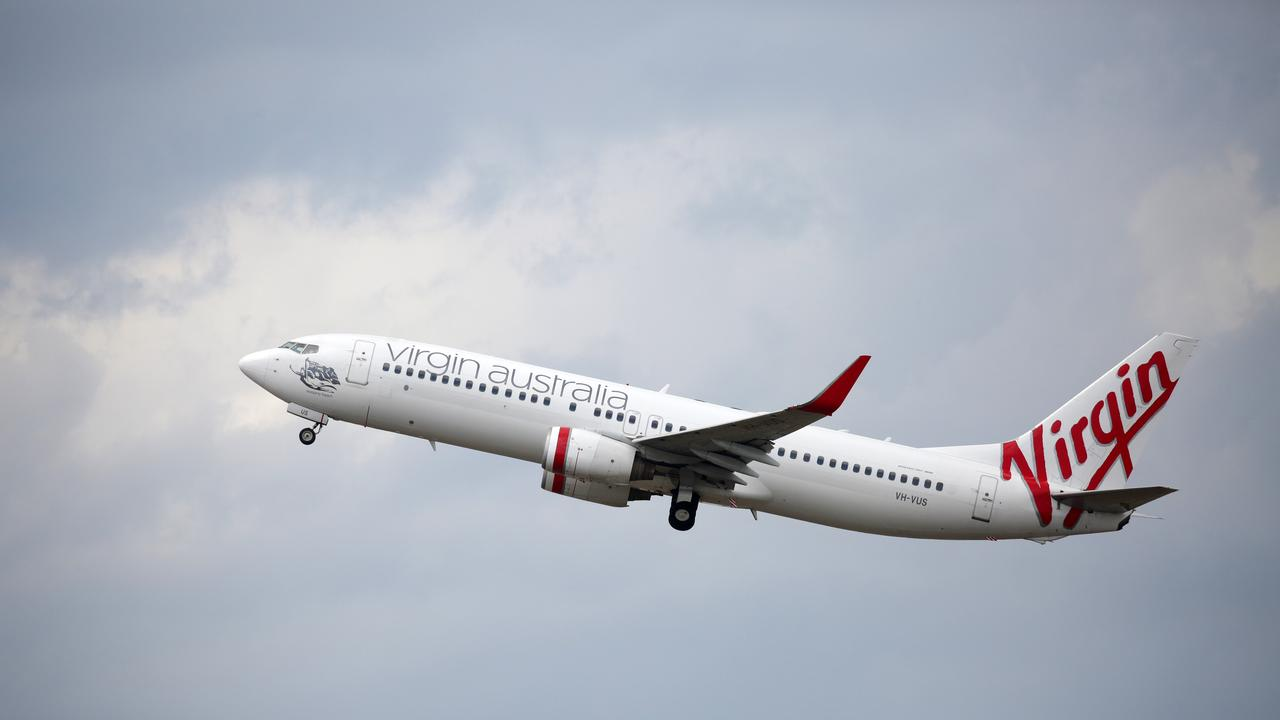 A Virgin Australia plane takes off at Sydney Airport. Photo: Christian Gilles