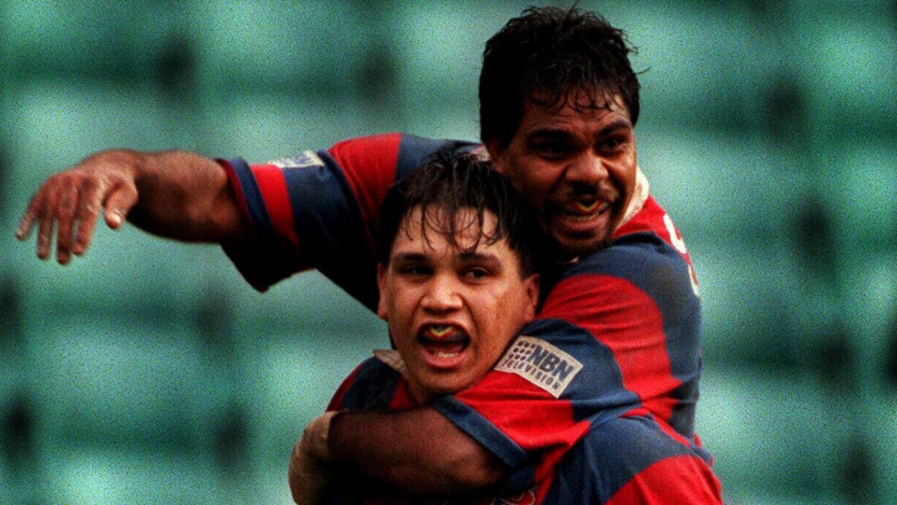 Owen Craigie is congratulated by Leo Dynevor after scoring for the Knights in 1997.