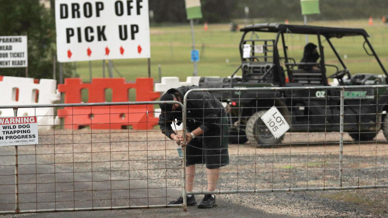 The Bluesfest Byron Bay front gates are locked shut with a metal chain by event security after ticket holders were told the event had been cancelled at the last minute. Picture: NCA NewsWire / Scott Powick