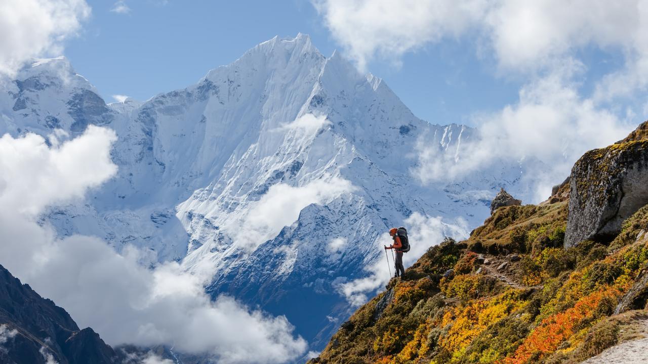 Hiker walking on train in Himalayas.