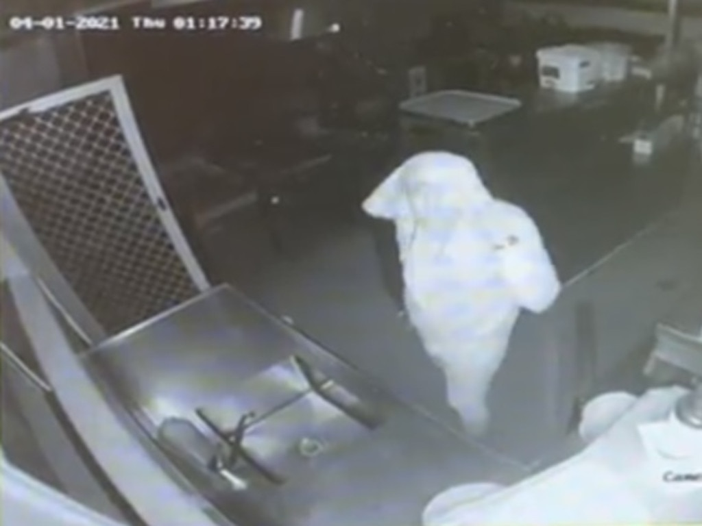 A thief tries to conceal his identity with a head covering.