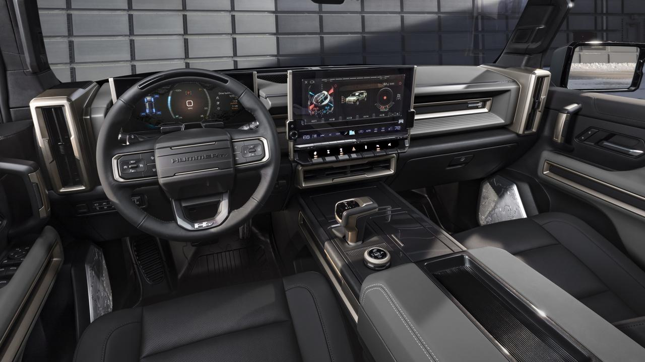 The interior is dominated by a massive central screen.