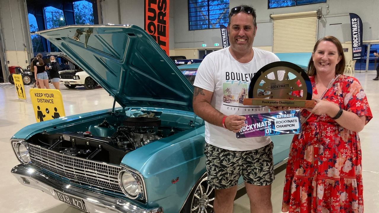 Paul Hart, pictured with his 1967 XR Ford Fairmont, celebrates with wife Jade after being crowned grand champion at the Rare Spares Rockynats.