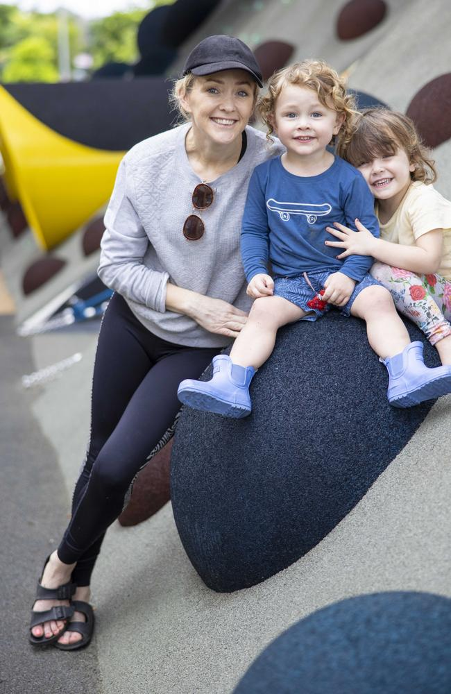 Brisbane Mum Suzy Walker with children Freddy, 2, and Isla, 3, enjoying a day at the park. Ms Walker says she doesn't use the word COVID when she talks to them. Picture: Peter Wallis