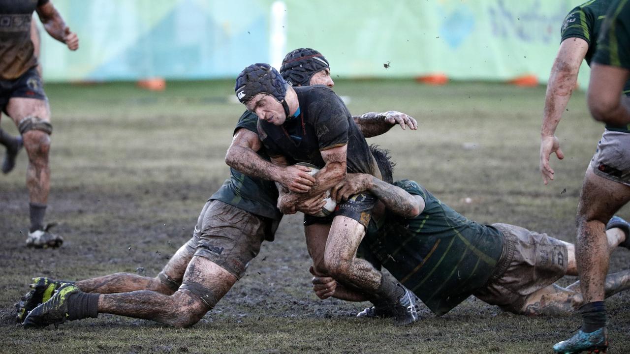 Chris Portors captured these great shots of a muddy battle between USC Barbarians and Caloundra in 2019. Picture: Christopher Portors