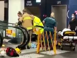Woman stuck in escalator after fall