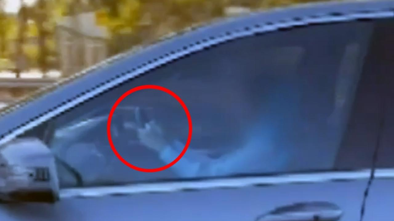 A woman has been caught reading a book while driving at high-speed with children in the car in Adelaide. Picture: 9 News