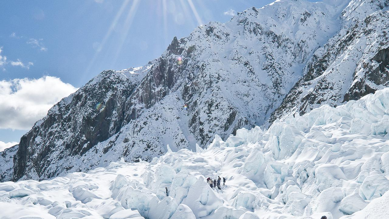 Tourists on a guided tour on the Franz Josef Glacier.