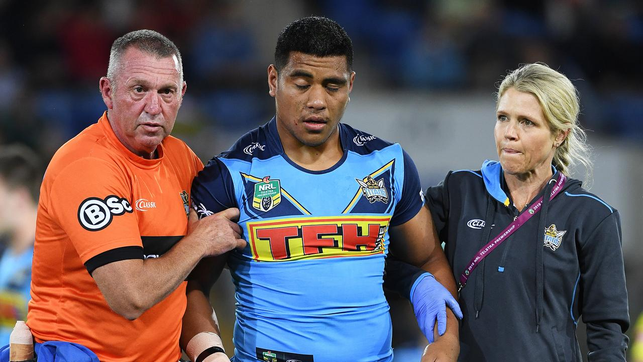 Moeaki Fotuaika comes off the ground after being concussed. Picture: AAP Image/Dave Hunt