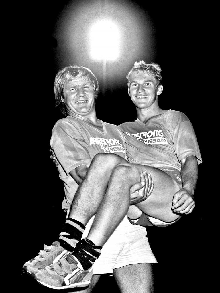 Former Ipswich Jets coach Tommy Raudonikis carries new halfback Allan Langer at training in 1980s. Picture: Brisbane Rugby League