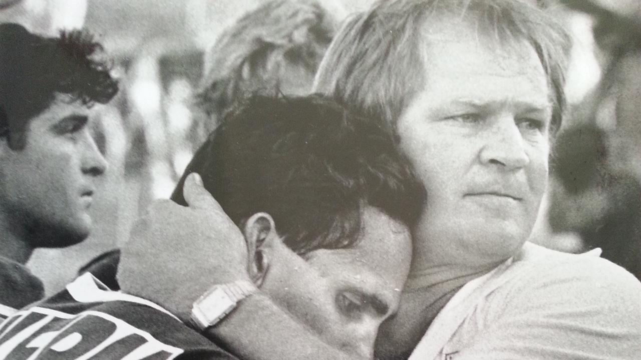 Former Ipswich Jets coach Tommy Raudonikis comforted his players at their Brisbane Rugby League grand final loss.