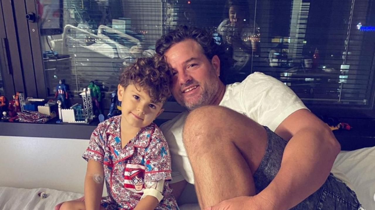 Dash with his dad Shaun Leather who has been by his side since his four-year-old son was flown from Bundaberg to Brisbane for treatment.
