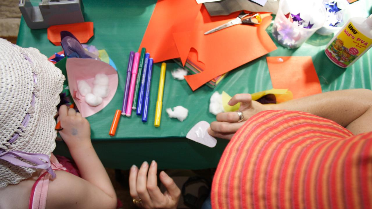 Generic photo of a child making various craft items.